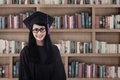 Beautiful female graduate smiling at library asian Stock Image