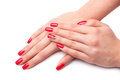 Beautiful female hand with red nails isolated on white Stock Images