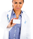 Beautiful female healthcare professional or doctor or nurse with blue stethoscope holding blank business card closeup portrait of Royalty Free Stock Image