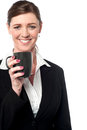 Beautiful female manager enjoying hot coffee corporate lady during work break Royalty Free Stock Photo