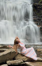 Beautiful female model posing in front of waterfall Royalty Free Stock Photo