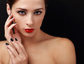 Beautiful female model with red lipstick and black nails polish looking Royalty Free Stock Photo