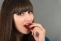 A beautiful female mouth eating a fresh strawberry close up of Royalty Free Stock Image