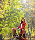 Beautiful female posing in a park with her bicycle shot tilt and shift lens Royalty Free Stock Image