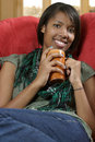 Beautiful female relaxing with coffee Royalty Free Stock Images