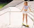 Beautiful female skater looking away Royalty Free Stock Photo