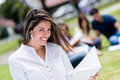 Beautiful female student smiling at the university campus Royalty Free Stock Images