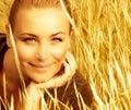Beautiful female on wheat field Stock Photography