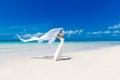 Beautiful fiancee in white wedding dress and big long white trai train stand on shore sea Stock Photo