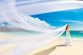 Beautiful fiancee in white wedding dress and big long white trai train stand on shore sea Stock Photos
