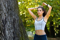 Beautiful fit female getting ready for workout Royalty Free Stock Photo