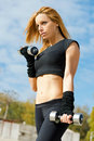 Beautiful fit woman exercising  outdoors Stock Image