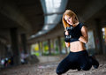 Beautiful fit woman lifting weights outdoors Stock Photography