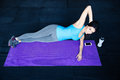 Beautiful fit woman working out on yoga mat at gym Royalty Free Stock Images