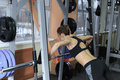 Beautiful fitnes girl is engaged in the gym doing exercise strengthens the chest