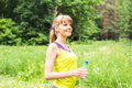 Beautiful fitness athlete woman with water after work out exercising outdoor portrait Royalty Free Stock Photo