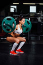 Beautiful fitness woman lifting barbell. Royalty Free Stock Photo