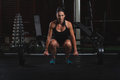 Beautiful fitness woman preparing to lift some heavy weights female body builder practising in the gym practice deadlift with Stock Image