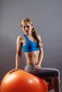 Beautiful fitness woman sitting on a exercise ball Stock Photos