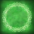 Beautiful floral frame on a green background with grunge effects. Royalty Free Stock Photo