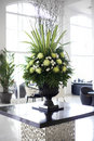Beautiful flower arrangement in large foyer white and green elegant Royalty Free Stock Photos