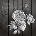 Beautiful flowers on a wooden texture black white Royalty Free Stock Image