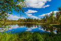 Beautiful forest lake with clouds. Finland Royalty Free Stock Photo