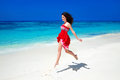 Beautiful free girl running on exotic beach with white sand and Royalty Free Stock Photo