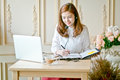 Beautiful freelancer female talking in a video conference Royalty Free Stock Photo