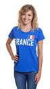 Beautiful french sports with blond hair and blue jersey Royalty Free Stock Photo