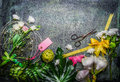 Beautiful fresh flowers pair of scissors and tools to create bouquet on rustic background top view border Stock Photos