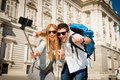 Beautiful friends tourist couple visiting spain in holidays students exchange taking selfie picture young and stick together Royalty Free Stock Photo