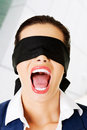 Beautiful frighten young blindfold woman portrait of a screaming Royalty Free Stock Image