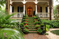 Beautiful front stairs and yard of historic home Royalty Free Stock Photo