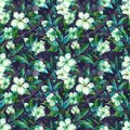 Beautiful fruit tree twigs in bloom. White and green flowers on gray background. Springtime. Seamless floral pattern.