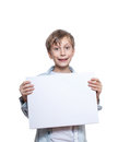 Beautiful funny blond boy wearing a blue shirt holding small blank banner smiling Royalty Free Stock Image
