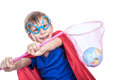 Beautiful funny child dressed as superman saving the earth having saved planet smiling and showing his fist environment concept Royalty Free Stock Images
