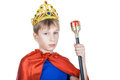 Beautiful funny child pretending to be a king wearing a crown looking powerful Stock Photography