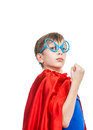 Beautiful funny child pretending to be superhero standing looking strong and showing his fist concept Stock Photography