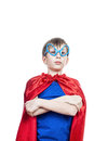 Beautiful funny child pretending to be superhero standing serious looking strong and powerful concept Stock Images