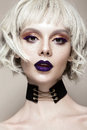 Beautiful funny girl in a white wig, with creative art make-up and freckles. Beauty face. Royalty Free Stock Photo