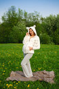 Beautiful funny pregnant woman in a suit lamb Royalty Free Stock Photos