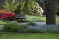 Beautiful garden design with combination of flowers trees and lawn Royalty Free Stock Image