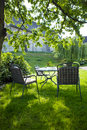 Beautiful garden with white table and chair Royalty Free Stock Photo