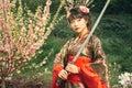 Beautiful geisha in kimono with samurai sword Royalty Free Stock Photo
