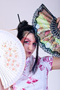 Beautiful geisha portrait of with fans Stock Images