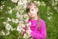 Beautiful gentle girl standing in a lush garden Royalty Free Stock Photo