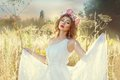 The beautiful gentle girl in white dress she stands a field grass Royalty Free Stock Photo
