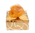 Beautiful gift box in gold paper with a silk rose Royalty Free Stock Photo