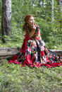 A beautiful ginger-haired girl in gipsy suit Royalty Free Stock Photos